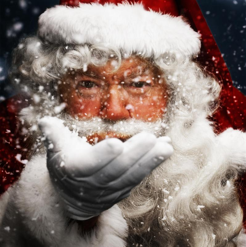 Father Christmas blowing snow, portrait, close-up