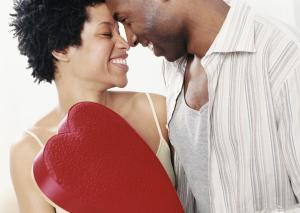 Couple Face to Face, Man Holding a Red Heart Shaped Box of Chocolates