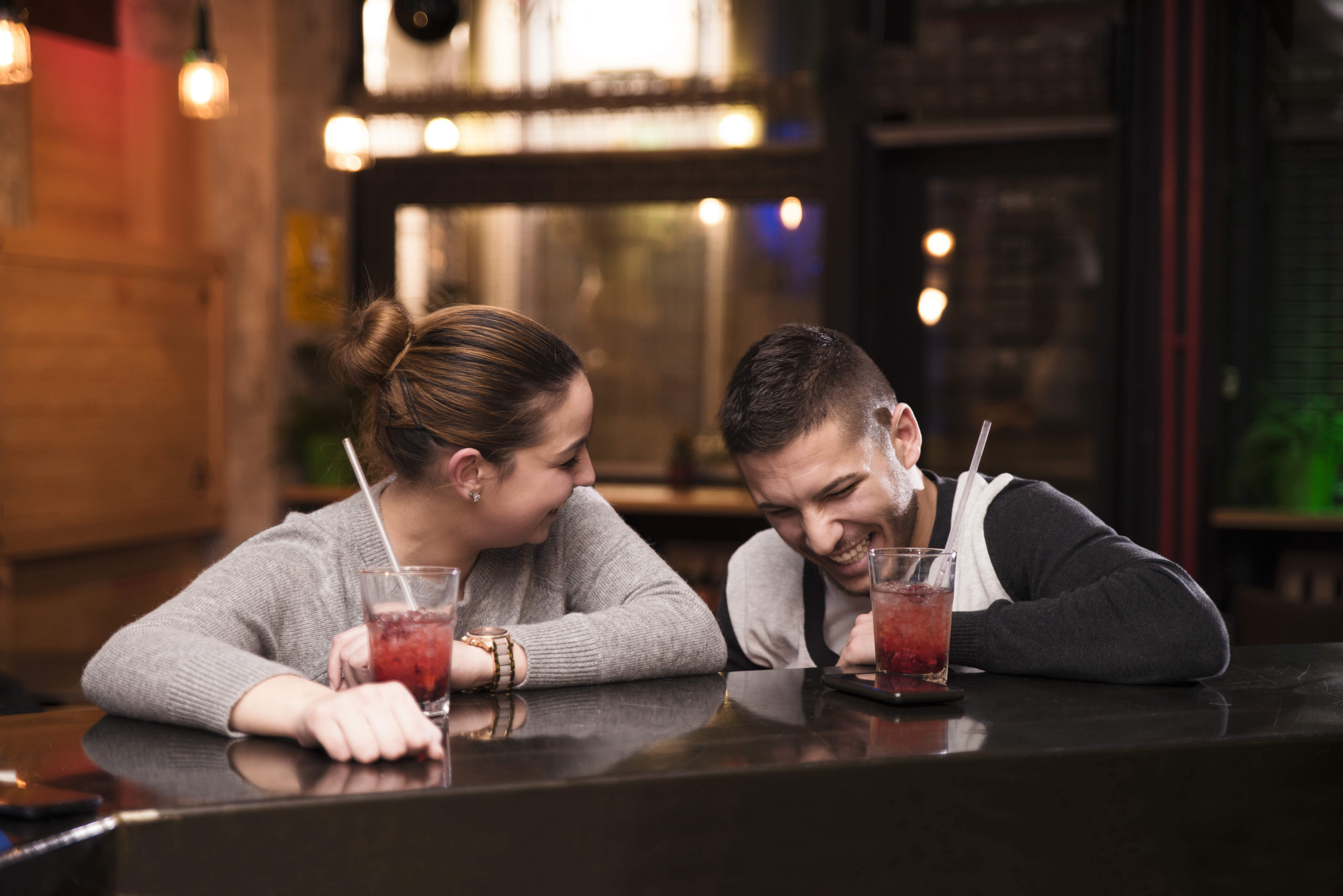 Happy young couple enjoying in cafe bar