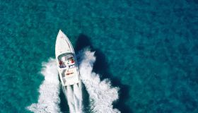 People riding in 40 foot sports boat, aerial view