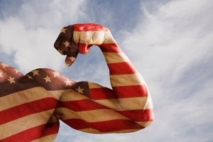 Flexing biceps covered with American flag