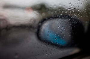 Raindrops fall on the window of a car