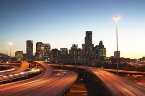 USA, Texas, Houston skyline, motorway, dusk (long exposure)