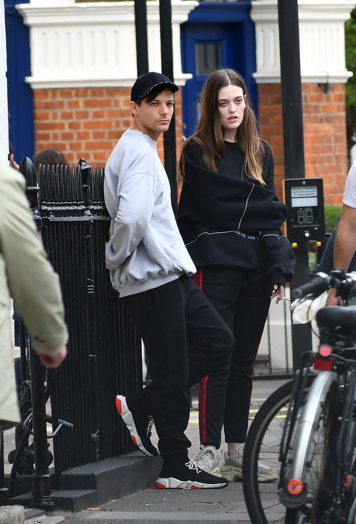 Louis Tomlinson and his sister Felicite Tomlinson aka 'Fizzy' have a cigarette on Belgravia Street