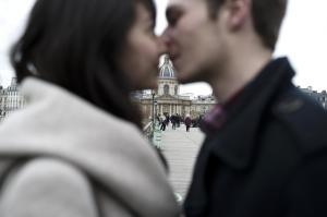 A couple kisses on the Pont des Arts, on