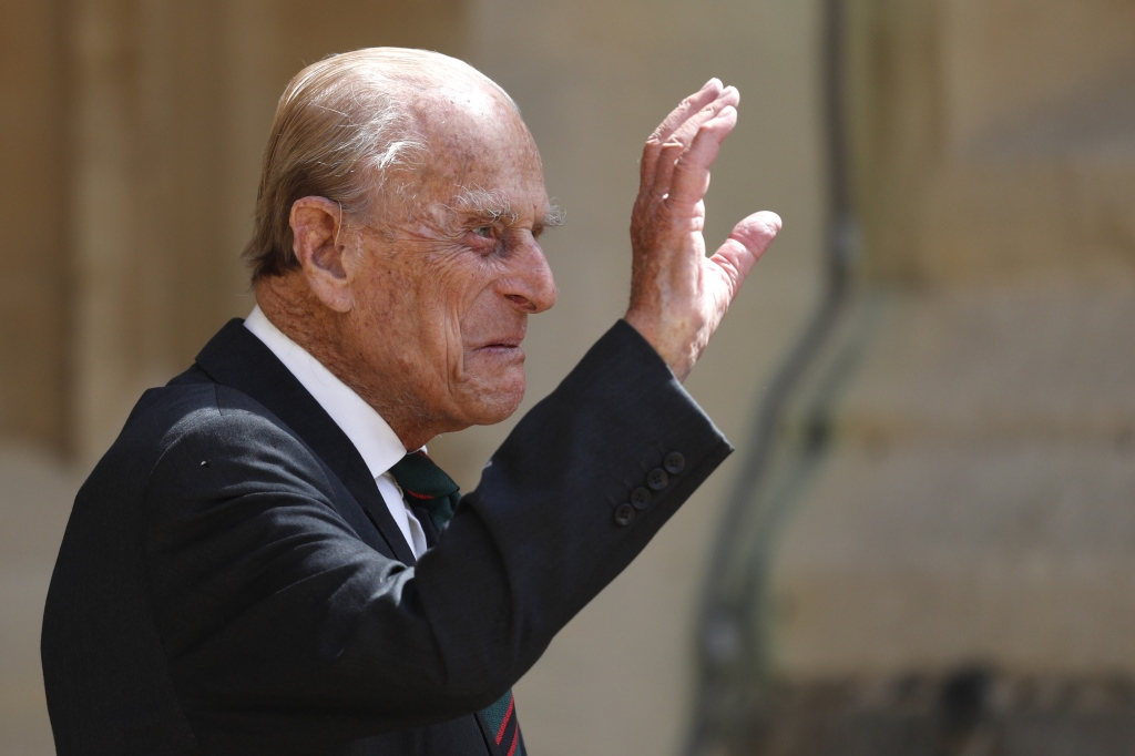 Britain's Prince Philip, Duke of Edinburgh waves as he takes part in the transfer of the Colonel-in-Chief of The Rifles at Windsor castle in Windsor on July 22, 2020.